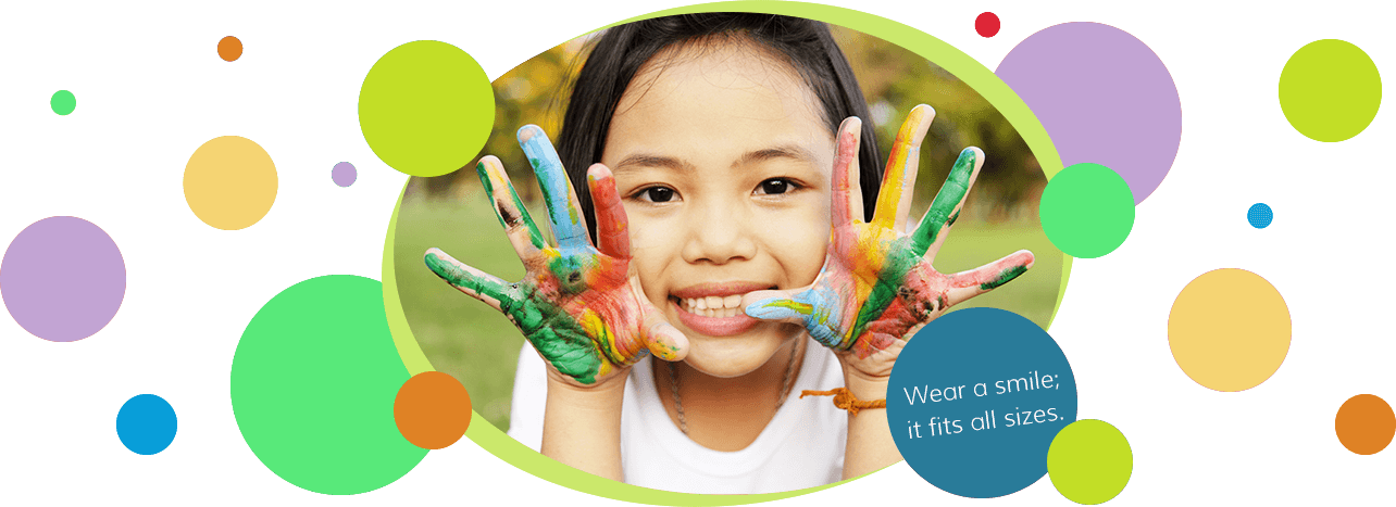 Girl with paint hands - Pediatric Dentist in Council Bluffs, IA