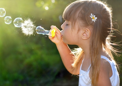 Girl blowing bubbles - Pediatric Dentist in Council Bluffs, IA
